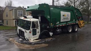 Recycling truck gets stuck in West Seattle sinkhole