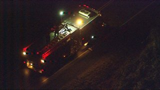 Crews rescue father, son from grounded boat in Carnation