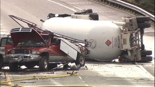 PHOTOS: Tanker carrying propane crashes, closes I-5, I-90