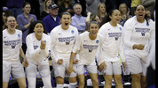 Players on the Washington bench cheer a call against Oklahoma during the first half of a second-round game in the NCAA women's college basketball tournament Monday, March 20, 2017, in Seattle. (AP Photo/Elaine Thompson)