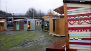 Tiny living pods for the Kenton Neighborhood Tiny Home Pilot houses are viewed in Portland, Ore. Local officials are thinking outside the box with plans to build