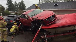 Car crashes, lands on boat near Portland
