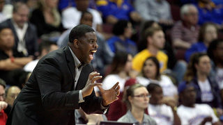 Washington hires Cameron Dollar as assistant coach