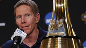 Gonzaga head coach Mark Few answers questions after receiving the 2016-2017 Coach of the Year trophy at a news conference Thursday, March 30, 2017, in Glendale, Ariz. (AP Photo/Matt York)