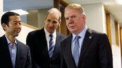 Seattle Mayor Ed Murray, right, walks past his husband, Michael Shiosaki, left, and his attorney, Bob Sulkin, before speaking to the media, Friday, April 7, 2017, in Seattle. (AP Photo/Elaine Thompson)