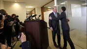 Seattle Mayor Ed Murray, left, is greeted by his husband, Michael Shiosaki, after reading a statement to the media 4/7/17, in Seattle. A lawsuit filed Thursday accuses Murray of sexually molesting a teenage high-school dropout in the 1980s.