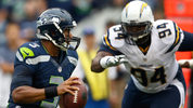 FILE: AUGUST 15: Quarterback Russell Wilson #3 of the Seattle Seahawks scrambles away from defensive end Corey Liuget #94 of the San Diego Chargers during the game at CenturyLink Field on August 15, 2014. (Photo by Otto Gruele/Getty Images)