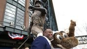 Seattle Mariners Hall of Famer Ken Griffey Jr. poses for a photo with Moose, the Mariners' mascot, after a statue of Griffey was unveiled Thursday, April 13, 2017, in front of Safeco Field in Seattle. (AP Photo/Ted S. Warren)