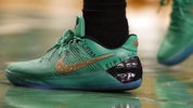Boston Celtics' Isaiah Thomas wears a message on his shoes in memory of his sister Chyna during the fourth quarter of a first-round NBA playoff basketball game against the Chicago Bulls Sunday. The Bulls won 106-102. (AP Photo/Michael Dwyer)