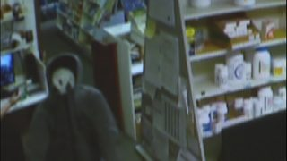 Video shows small town pharmacy being robbed at gunpoint