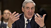FILE - In this June 19, 2013, file photo, former FBI Director Robert Mueller testifies on Capitol Hill in Washington. (AP Photo/J. Scott Applewhite, File)