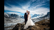 Two hikers used the last of their energy to stand proudly amid snowy peaks as they became the first couple to exchange vows in a wedding dress and tux on Mount Everest. (Photo: CharletonChurchill/charletonchurchill.com)