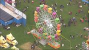 At least three people, including one child, fell from a Ferris wheel at the Rhododendron Festival in Port Townsend on Thursday night. (Image: Chopper 7)