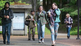 Students leave The Evergreen State College campus in Olympia after a threat prompted a student alert and evacuation on Thursday, June 1, 2017. (Tony Overman /The Olympian via AP)