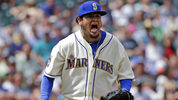 Seattle Mariners starting pitcher Felix Hernandez turns and lets out a yell after striking out Oakland Athletics' Jed Lowrie to end the top of the sixth inning of a baseball game, Sunday, July 9, 2017, in Seattle. (AP Photo/Elaine Thompson)