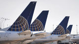 FILE: United Airlines jets sit at gates at O'Hare International Airport on September 19, 2014 in Chicago, Illinois. (Photo by Scott Olson/Getty Images)
