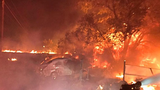 A cat climbed onto power lines, caught fire, and started this blaze that destroyed outbuildings, cars and a camper in Grant County, August 2017.