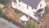 """Seattle detectives returned August 23, 207 to dig for evidence at Green Lake house where police say 3 brothers had """"obsession with young children."""" KIRO 7 chopper kept wide angles and out-of-focus shots to not interfere with the investigation."""