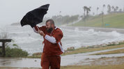 Matt Looingvill struggles with his umbrella as he tries to walk in the wind and rain, Friday, Aug. 25, 2017, in Corpus Christi, Texas. (AP Photo/Eric Gay)