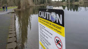 A sign warns of the toxic algae problem in Waughop Lake in Fort Steilacoom Park, Lakewood, March 8, 2016.