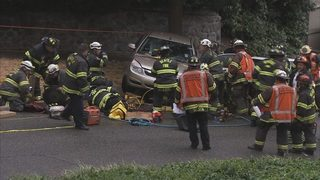 Woman run over while trying to stop car from rolling down hill