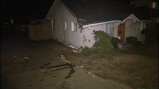 Truck crashes into West Seattle home