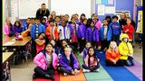 More than 80 local first-graders at Liberty Elementary School in Marysville received new winter coats on Thursday. (Courtesy: Marysville Fire District)