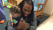 Richard Sherman visits Ellie, a 4-year-old patient at Mary Bridge Children's Hospital in Tacoma. Her favorite doll is