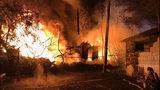 Crews battle stubborn tire fire in Everett