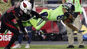 Seattle Seahawks wide receiver Doug Baldwin (89) is hit out of bounds by Arizona Cardinals safety Budda Baker (36) during the second half of an NFL football game, Thursday, Nov. 9, 2017, in Glendale, Ariz. (AP Photo/Rick Scuteri)