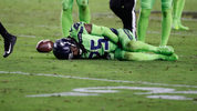 Seattle Seahawks cornerback Richard Sherman (25) lies injured on the turf after tackling Arizona Cardinals wide receiver John Brown during the second half of an NFL football game, Thursday, Nov. 9, 2017, in Glendale, Ariz. (AP Photo/Rick Scuteri)