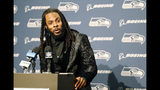 Seattle Seahawks cornerback Richard Sherman talks to reporters during a post-game press conference following an NFL football game against the Houston Texans, Sunday, Oct. 29, 2017, in Seattle. (AP Photo/Stephen Brashear)