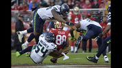San Francisco 49ers tight end Garrett Celek (88) is tackled by a group of Seattle Seahawks defenders during the second half of an NFL football game Sunday, Nov. 26, 2017, in Santa Clara, Calif. (AP Photo/Don Feria)