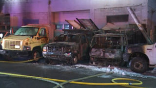 Fire burns several cars, spreads to building