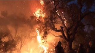 Snohomish County fire crews defend homes from raging blaze in CA