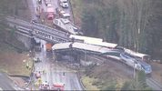 Crews moved the derailed train cars away from the crash scene on Dec. 20, 2017. These photos show before the cleanup of the crash. Image: Chopper 7