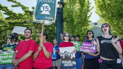 Members of 15 Now Tacoma joined Raise Up Tacoma, Labor activists and union members Tuesday 06/30/15 for a minimum wage rally at the Theater On The Square in Tacoma. Dean J. Koepfler, The News Tribune