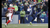Seattle Seahawks cornerback Shaquill Griffin and free safety Earl Thomas, right, both get their hands on a pass intended for Arizona Cardinals wide receiver Jaron Brown (13) that was intercepted by Griffin during the second half of an NFL football game Sunday, Dec. 31, 2017, in Seattle. (AP Photo/Elaine Thompson)