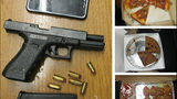 The confiscated gun, cell phone and food from an alleged robber in University Place Friday evening. Pierce County Sheriff's Department.