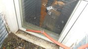 A Spanaway man shot a suspected burglar through this window Feb. 19 after he found the prowler crouched outside the room where his infant and toddler had been sleeping. Courtesy photo Pierce County Sheriff's Department