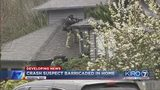 VIDEO: Crash suspect barricaded in home