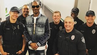 Officers with Kent Police strike a pose with Snoop Dogg