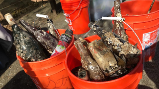 Divers pull bottles, fishing gear from Tacoma