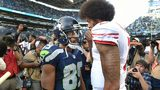 Wide receiver Doug Baldwin #89 of the Seattle Seahawks speaks with quarterback Colin Kaepernick #7 of the San Francisco 49ers after the game at CenturyLink Field on September 25, 2016 in Seattle,Washington.