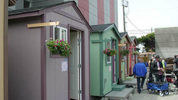 Tiny houses on display May 30, 2018 as Seattle Mayor Jenny Durkan announced an increased effort to address homelessness with the homes. (Matt Pitman, KIRO Radio)