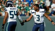 Russell Wilson #3 high fives Bobby Wagner #54 of the Seattle Seahawks during the first half against the Green Bay Packers at Lambeau Field on September 10, 2017 in Green Bay, Wisconsin. (Photo by Joe Robbins/Getty Images)