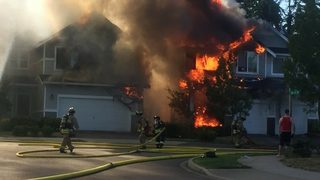 PHOTOS: Fire burns two homes in Snohomish County