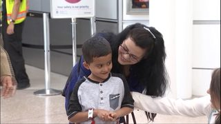 Asylum seeker reunited with young son