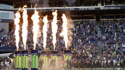 Seattle Seahawks players take the field as fire effects go off before an NFL football preseason game against the Indianapolis Colts, Thursday, Aug. 9, 2018, in Seattle. (AP Photo/Stephen Brashear)
