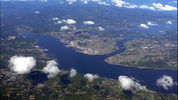Port Orchard and Sinclair Inlet (left), Dyes Inlet (right, middle distance); Manette and Warren Avenue Bridges (left to right) across Port Washington Narrows (right center); (Bremerton, Washington)